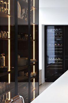 Liedssen kitchen interior. Dark glass cupboard doors.