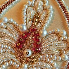 http://www.needlenthread.com/2015/07/stylized-pomegranate-in-pearl-goldwork-embroidery.html