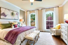 Sunrise Homes, Dauphine Model - With the built in head board and floor to ceiling windows this master bedroom exudes character, while having a touch of elegance with the softer colors.