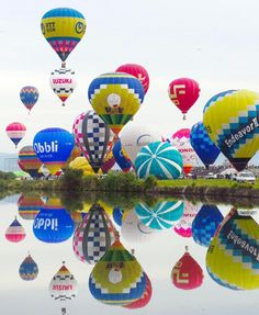 SAGA, JAPAN - Colorful hot air balloons soar in the air and reflect on the river for the opening of Saga International Ballooon Festival at Saga city in Saga prefecture in Japan's southern island of Kyushu on October 30, 2008. Some 100 hot air balloons from 14 countries will take part in various competitions through November 3.