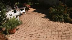 Learn about different hardscape materials -- from brick and flagstone to pavers -- for your next landscaping project.