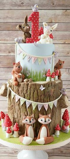 Woodland creatures 1st birthday cake - For all your cake decorating supplies, please visit http://www.craftcompany.co.uk/