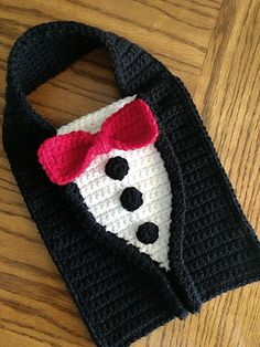Dress up your baby in the cutest formal-wear with the Pretty Spiffy Tuxedo bib. - Dress up your baby in the cutest formal-wear with the Pretty Spiffy Tuxedo bib. From baby's first - Crochet Dog Clothes, Crochet Baby Bibs, Crochet For Boys, Cute Crochet, Pet Clothes, Crochet Crafts, Crochet Projects, Knit Crochet, Baby Beanie Crochet Pattern