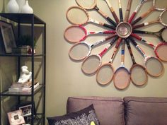 handemade tennis raquet statement piece ~ Kristin's 300 Square Foot Brooklyn Abode
