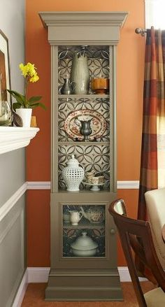 Use tin ceiling/back splash tiles in the back of a bookcase. The back splash is available at Home Depot: