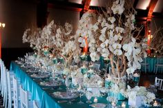 Manzanita trees with orchids and tiffany blue linens