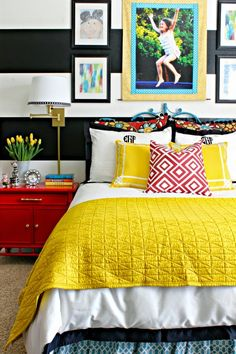 Bold, colorful girl's bedroom  ||  black and white stripes  ||  glossy red nightstands  ||  swing arm wall sconces  ||  Crane and Canopy Linden bedding  ||  vintage peacock headboard ||  from dimplesandtangles.com
