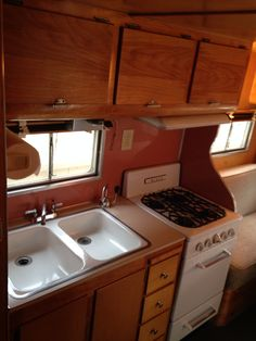 Our Aljoa Sportsman vintage camper interior circa 1954 featuring double sinks