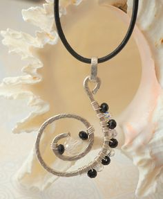 Silver Wire Wrapped Black and Crystal Spiral Pendant.  DesignedByDonnaD.etsy.com