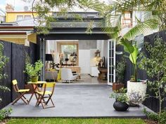 much over wide but with its modern renovation and addition, this wooden terrace house in. Terrace Floor, Small Terrace, Wooden Terrace, Terrace House Exterior, Outdoor Spaces, Outdoor Living, Terrasse Design, Narrow House, House Extensions