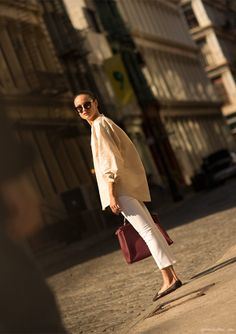 Prada shades, Tome tunic, white Mih jeans, Fendi red Peekaboo bag / Garance Doré