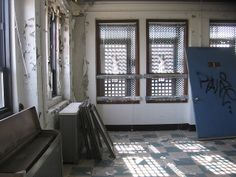 windows and doors in an abandoned hospital