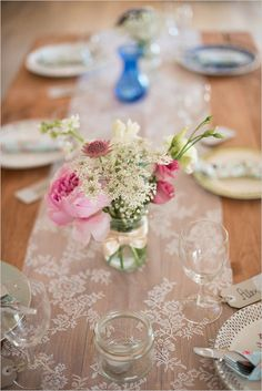 Simple runner make from ikea curtains with vintage glass vases. Captured By: Christie Graham Photography ---> http://www.weddingchicks.com/2014/05/15/create-a-darling-wedding-for-under-5k/