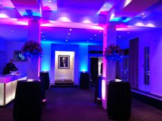 Blue and Lights create Funky Lighting for a party and a flower display by @Hayford Rhodes in the Foyer Bar