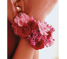 Set the trend with sizzling red spray roses and gentle pink flowers, wrapping her wrist like a glamorous bangle bracelet. - TF164-1B