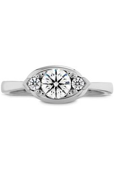 """Engagement Rings - What Your Engagement Ring Says About You -  Something Special Your ring has: An ornate, multi-diamond style You are: One-of-a-kind. """"You have an appreciation for unique items and one-offs,"""" Sabatino says. """"And you don't mind a little work or digging, because 'the find' is totally worth it."""" A die-hard vintage lover, you like your possessions—and your people—a little eccentric and unconventional."""