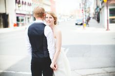 bride and groom walking on the street