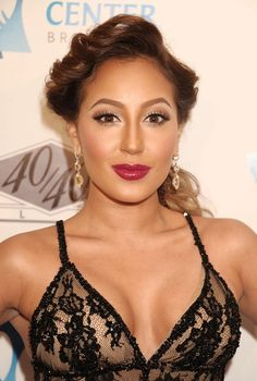 Splendid paragon of beauty Adrienne Bailon ... Snazzy Styles... The trio released two studio albums together