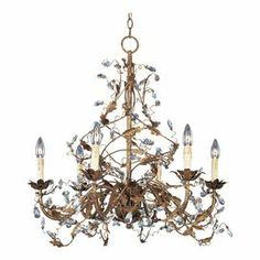 """Iron chandelier in etruscan gold with winding vine and crystal accents.   Product: ChandelierConstruction Material: IronColor: Etruscan gold Features: Constructed of ironUL listed for dry location      Accommodates: (6) 60 Watt candelabra base bulbs - not included     Dimensions: 28.5"""" H x 26.5"""" Diameter"""