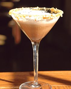 Snickers Bar     Ingredients:  1/2 oz. Amaretto  1/2 oz. Carmel vodka  1/2 oz. Godiva Dark Chocolate  1/2 oz. Half & half  Spoonful of chocolate syrup    Method:  Shake with ice, strain into martini glass with rim dipped in caramel syrup and chopped honey-roasted peanuts.