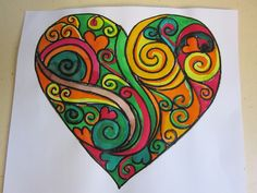 Heart shaped Zentangle painted by year 1 with watercolour paint.