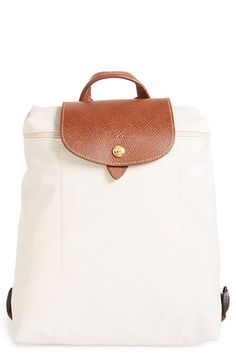 $94 - backpack Free shipping and returns on Longchamp 'Le Pliage' Backpack at Nordstrom.com. Strap on a stylish standby with a durable, water-resistant nylon backpack topped with a textured leather handle and logo-embossed flap.