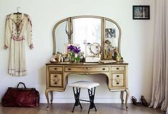 """The idea of a vanity is a romantic one,"" says Shiva of her gilded French vanity, which she's topped with jewelry boxes, mementos, natural beauty products from her own line, and fragrances including Regina Harris's Amber Vanilla perfume oil. ""My grandmother had one, and I've wanted my own ever since."" A vintage-clothing devotee, Shiva pounced on this white dress at L.A.'s twice-yearly Vintage Expo and scored the satchel from the Rose Bowl flea."