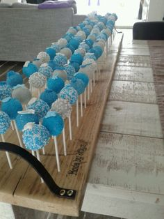Baby boy is born cake pops.