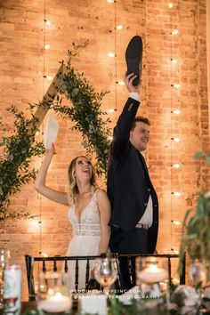 This beautiful boho bride did the shoe game at her wedding! But her best wedding decision was buying her wedding dress from the Wedding Shoppe! | shop hundreds of styles in all sizes online or in store today! | fun bride and groom | fun wedding reception | romantic bride | all black suit for groom | unique wedding photos Allure Bridesmaid, Bridesmaid Dresses, Wedding Dresses, Wtoo Bridal, Bridal Gowns, Wedding Colors, Wedding Styles, Wedding Photos, Wedding Shoppe
