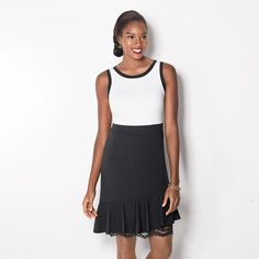 Black and white ponte dress with lace peeking out from under the asymmetrical ruffle hem. A timeless black and white combo for any summer occasion. Avon Fashion, Fashion Wear, Fashion Online, Womens Fashion, Avon Clothing, White Tank Dress, Dress Black, Colorblock Dress, Black Trim