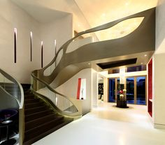 A home designed by architect Richard Landry in Singapore, with a curved metal staircase. He switched his focus to Asia in 2008 when US economy faltered.