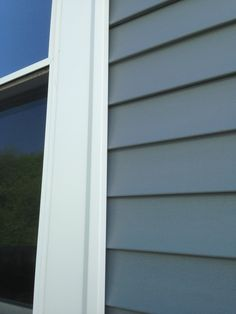 Mastic Carvedwood Vinyl Siding in English Wedgewood with White aluminum Custom Trim