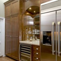 This design provides a full pantry of storage on left plus a full sized refrigerator.  I would ditch the added wine cooler. Built In Bar Design, Pictures, Remodel, Decor and Ideas - page 9
