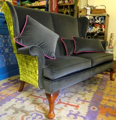 Re-upholstered Parker Knoll loveseat in charcoal & lime velvet. Finished with matching velvet cushions with a hit of pink piping.