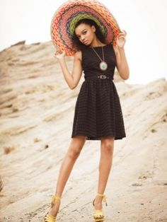 black dress with colorful accessories