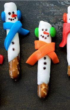 Dish up winter fun food that's easy enough for the kids to make! These pretzel rod snowmen are super cute and taste great too!