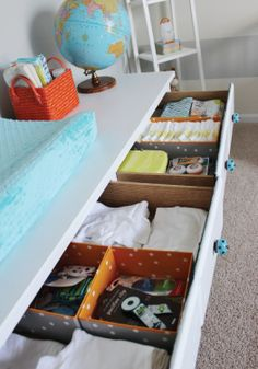 Easily organize nursery drawers with small storage boxes.