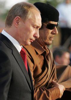 Vladimir Putin Photos Photos - President Vladimir Putin of Russia meets with Libyan leader Muammar Qadaffi on April 16, 2008 In Tripoli, Libya. Putin is in Libya for a two-day official visit to rebuild Russian-Libyan relations. - Vladimir Putin Meets With Libyan Leader Moamer Kadhafi