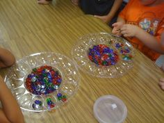"""Kids roll, and fill each cup up with five, moving on when it the cup reaches five, but not before. Kindergarten and Mooneyisms: Math Game - """"Fill-er-Up Five"""""""