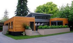 exterior of shipping container home . modern . gorgeous . wood panel