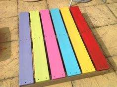 Rainbow stage for our reception outdoor area, made from an old pallet I sanded down and outdoor wood paints.