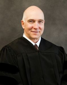 Judge Sylvester rec. his bachelor's degree from the Univ MD in '73 after being honorably discharged from the U.S. Army. He received his law degree from Univ of Georgia in '76.   He was in general private law practice untilJan '91. He was a trainer on the national level for the Nat'l College of DA's & lectured for the CO DA's Council. He left the DA's Office after being appointed to the District Court in Aug. 2001. Since Oct of 2006, he has served as the Chief Judge of the 18th Judicial…