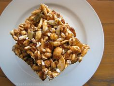 Chewy Energy Bars:  3 cups puffed whole grain cereal (such as Kashi)  1/2 cup nuts (any kind, I used cashews & sunflower seeds because that's what I had)  1/2 – 3/4 cup assorted dried fruit (I used chopped apricots & golden raisins)  1/3 cup creamy nut butter (peanut, almond, sunflower or cashew – any kind will work)  1/4 cup agave (or honey)  1/4 cup brown rice syrup