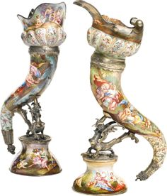 Two enamelled silver or silver-gilt drinking horns, Austro-Hungarian, early century Estimate - USD LOT SOLD. Porcelain Ceramics, Ceramic Pottery, Austro Hungarian, Antique China, Cup And Saucer Set, Silver Enamel, Horns, Candle Holders, Auction