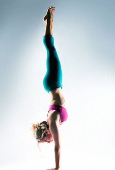Prepping for a full handstand like this one? Begin with the half-handstand. Here, the step-by-step instructions (plus, two yoga poses that will make you strong enough for both)