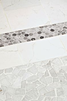 Floor Tiles With a Good Grip: Large, rectangular floor tiles are wheel-friendly; smaller border tiles and irregular shapes in the shower have plenty of grout for extra grip.