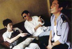 重慶森林.    faye wong with tony leung on the set of chungking express with its director, wong kar wai.