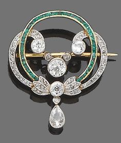 An emerald and diamond brooch, circa 1910  Designed as a millegrain-set old brilliant and rose-cut diamond swirl, surrounding a calibré-cut emerald circlet, suspending at its centre a millegrain-set old brilliant-cut diamond swag centre and at its base a collet-set pear-shaped diamond drop, mounted in silver and gold, diamonds approx. 1.80ct. total, length 3.3cm.