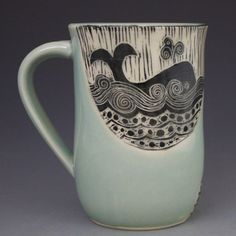 Patricia Griffin's handmade mugs with whales in a design that looks like a woodcut. Great for a beach house!