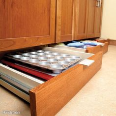 Turn wasted toe-kick cavities into clever flat storage space for serving trays, cutting boards and baking pans.